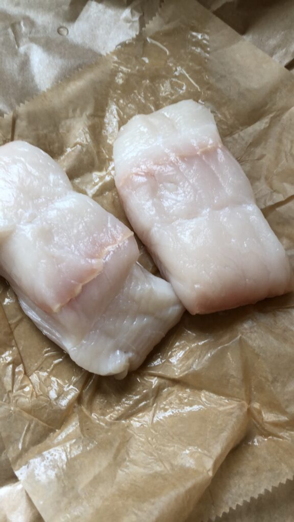 two pieces of halibut fish