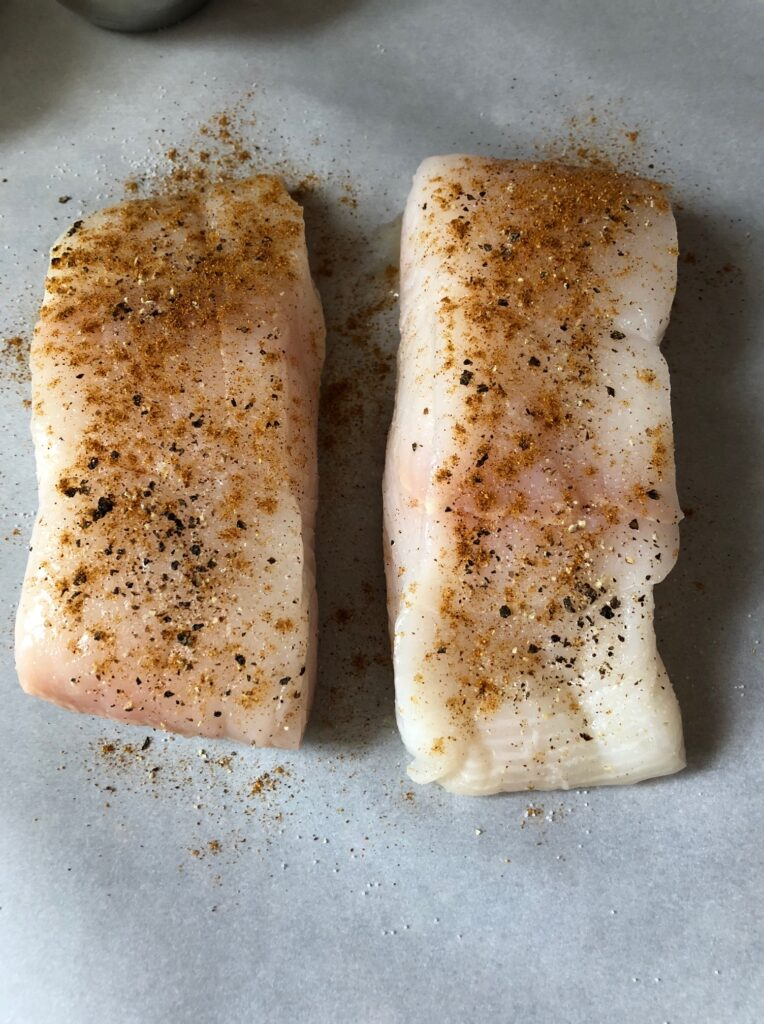halibut filets with crush pepper and seasoning