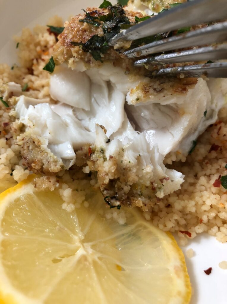 flaky white fish with couscous
