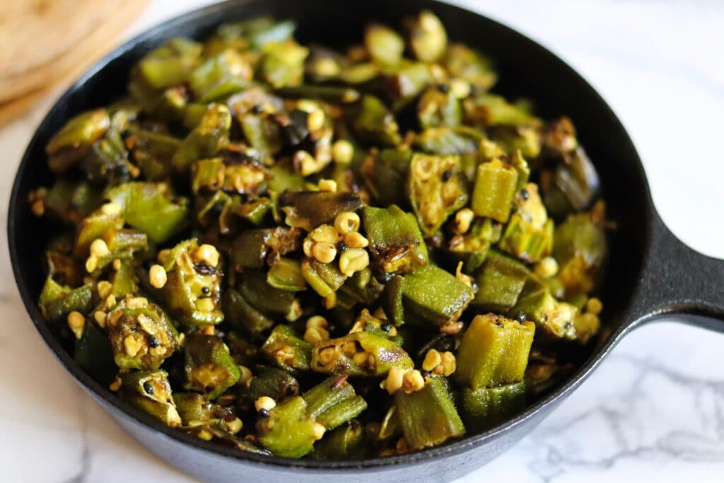 Finely chopped okra with turmeric mustard seeds and cumin seeds