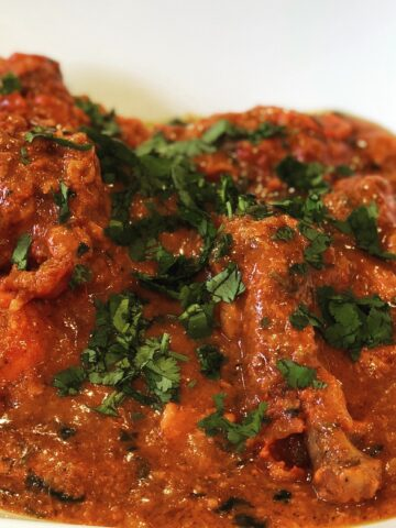 Dhaba Chicken Curry bone in chicken masala spicy curry indian cilantro herb slow roasted chicken