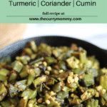 Turmeric cumin seeds and mustard seeds mixed with tender cooked fresh okra.