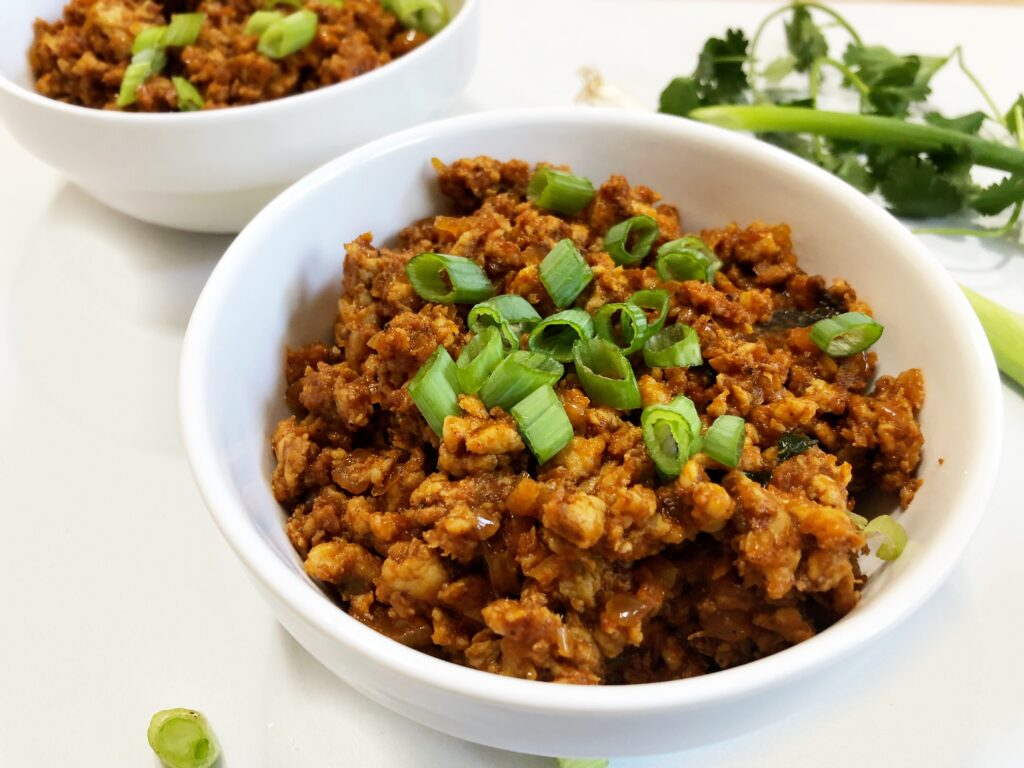 A spicy minced meat curry in two white bowls