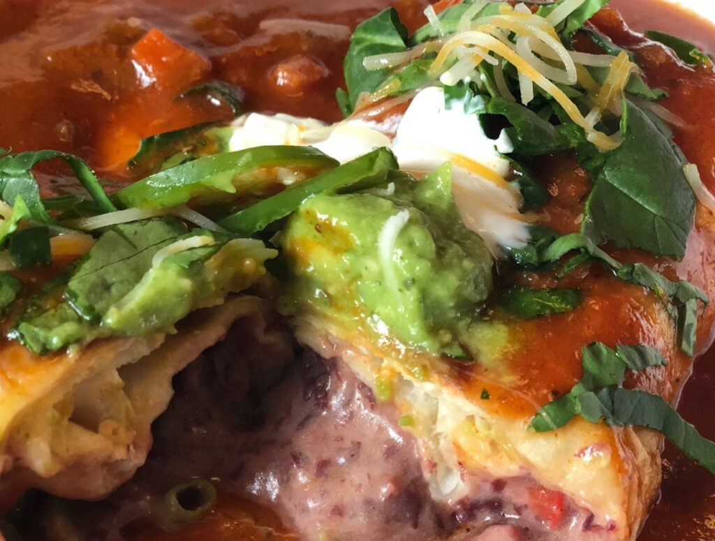 inside of a saucy burrito