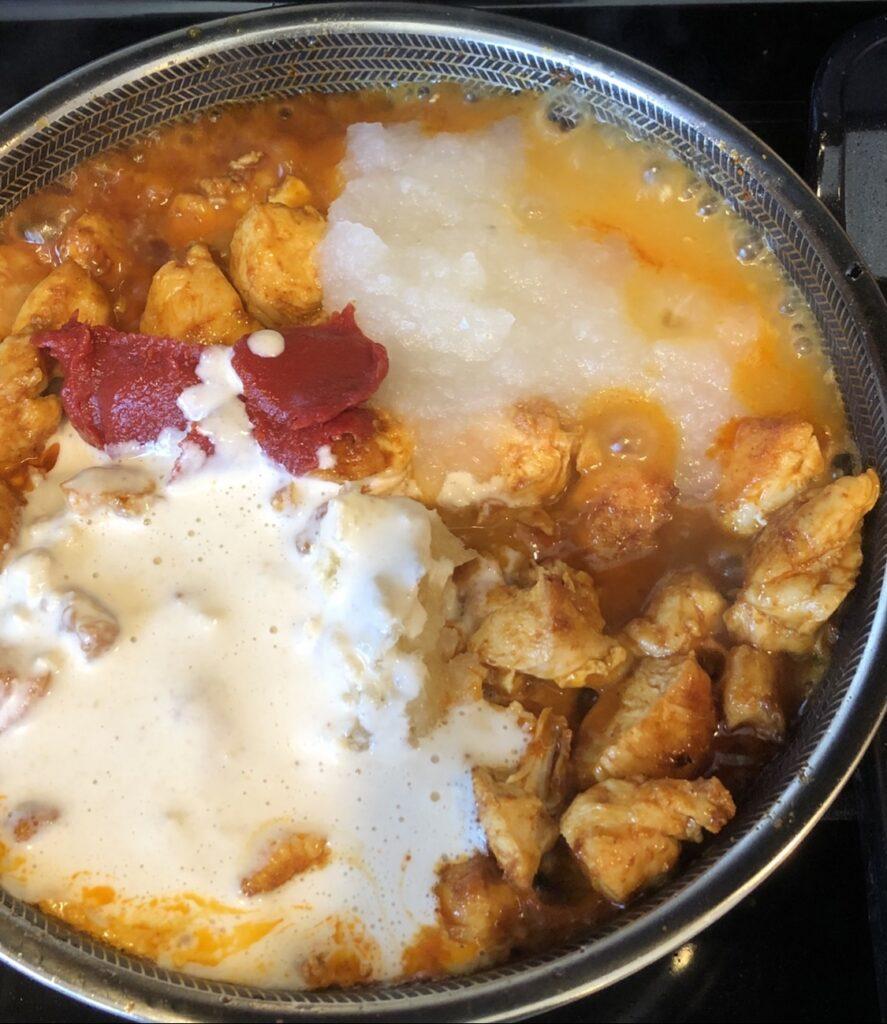 ingredients for chicken tikka masala in a pot