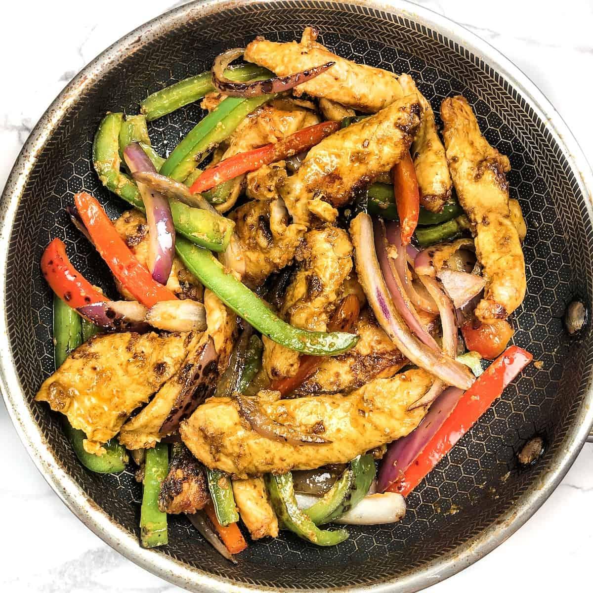 hexclad pan with boneless tandoori chicken