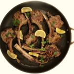 Pan Seared Lamb Chops with cilantro and lemon wedges