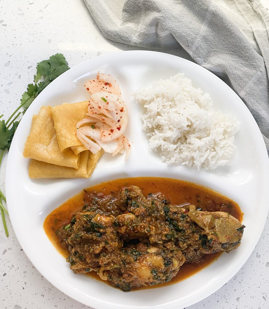 three compartment dish with desi chicken in the large, basmati rice and tortilla in small