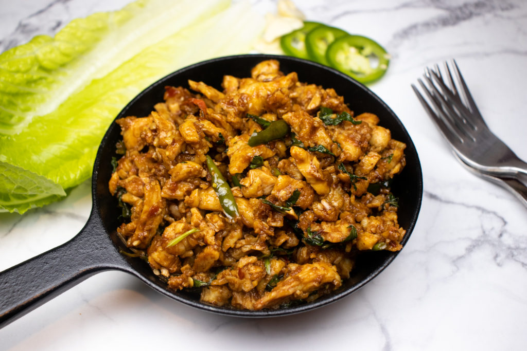 small pieces of chopped chicken flavored with thai chillies and cilantro