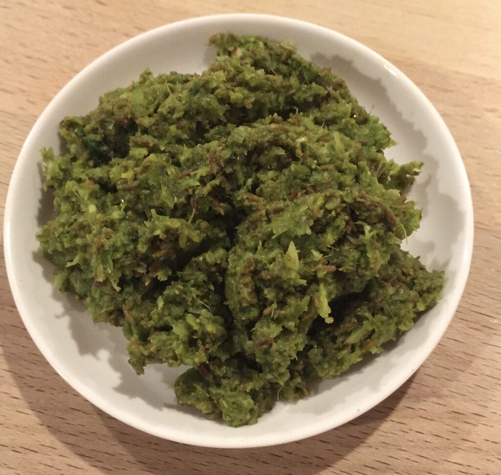 homemade zhoug sauce in a white dish.