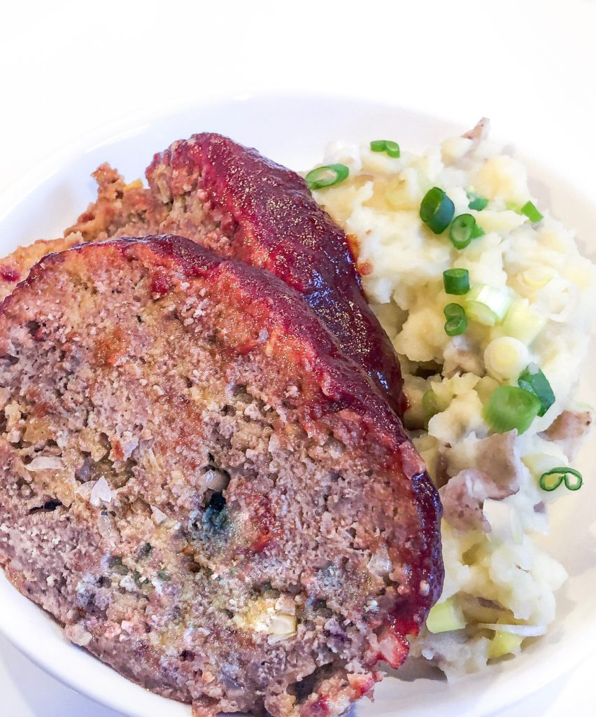 Mashed potatoes with beef meatload slices