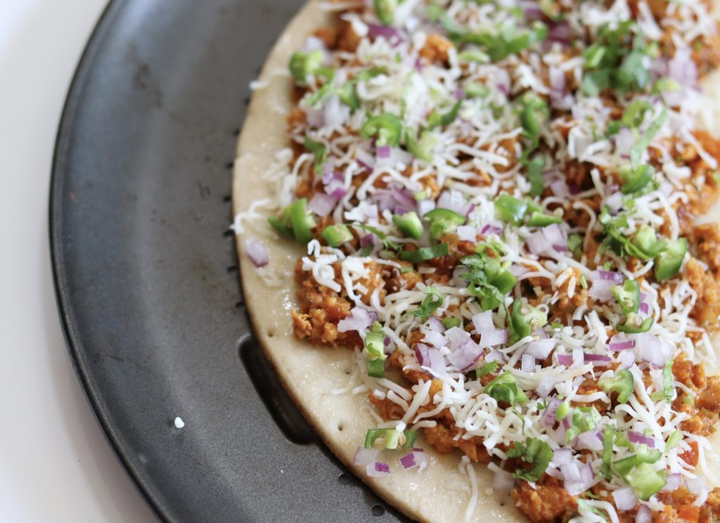 gluten free crust pizza topped with spicy minced meat.