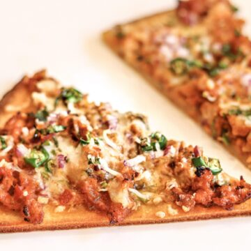 Pizza topped with spicy minced meat.