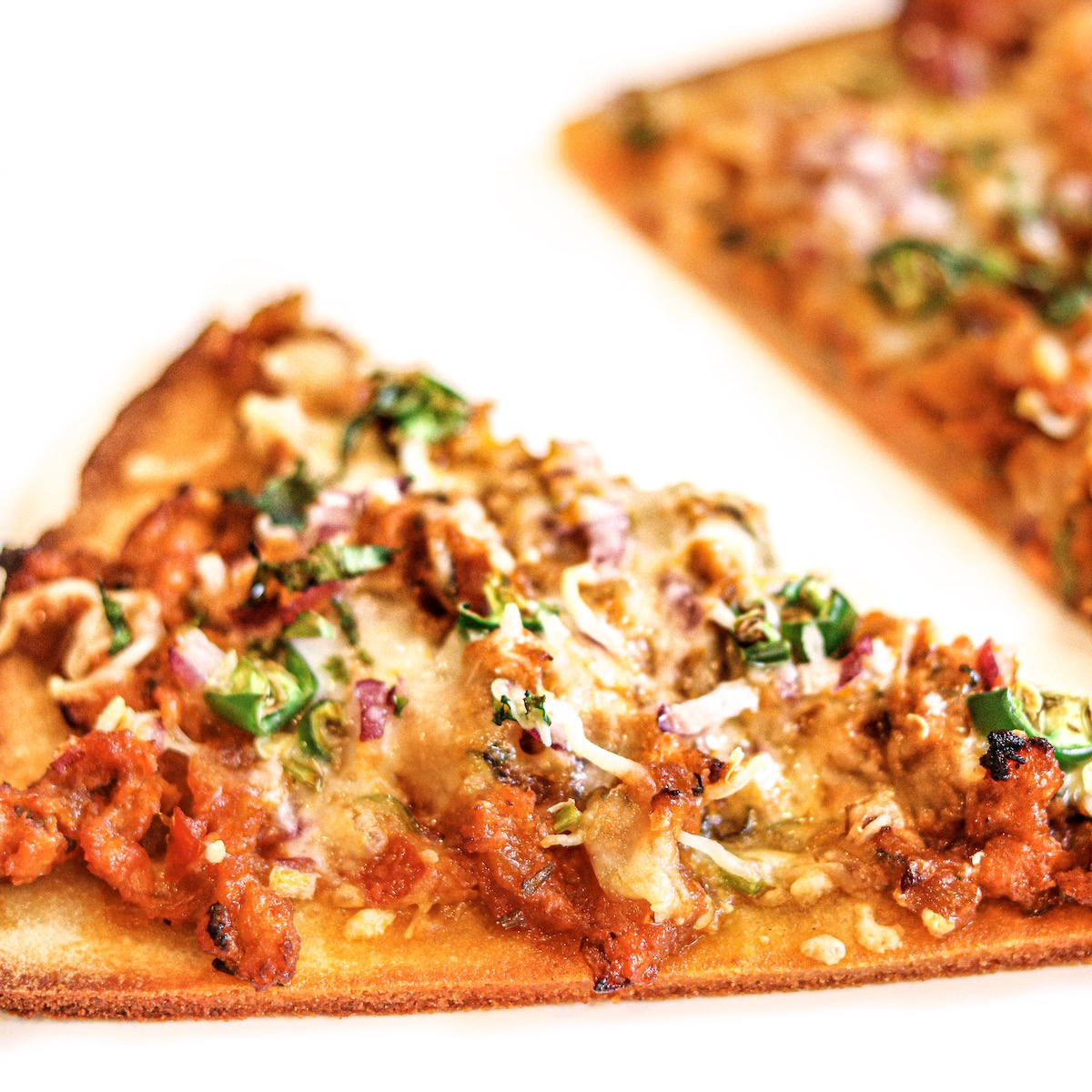 kheema pizza an indian pizza with chicken and spices on cauliflower crust