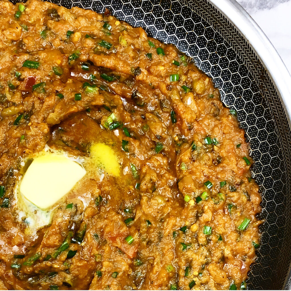 pav bhaji in a hexclad pan with butter