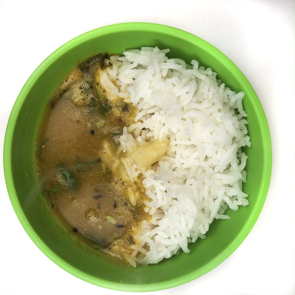 kid friendly green bowl with instant pot sambar and white rice.