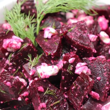 A steamed red beet salad with dill and feta cheese.