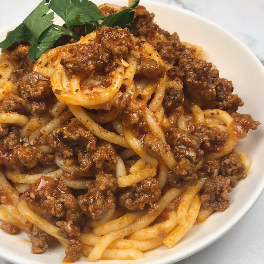 Pasta dish with thick meat sauce.