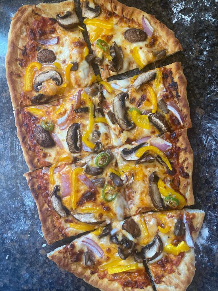 Grilled pizza with vegetarian toppings.