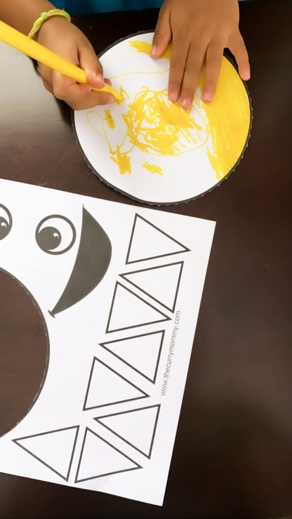 Cut and glue a sun activity for kids
