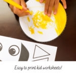 A child doing a sun cut and glue activity worksheet by the curry mommy