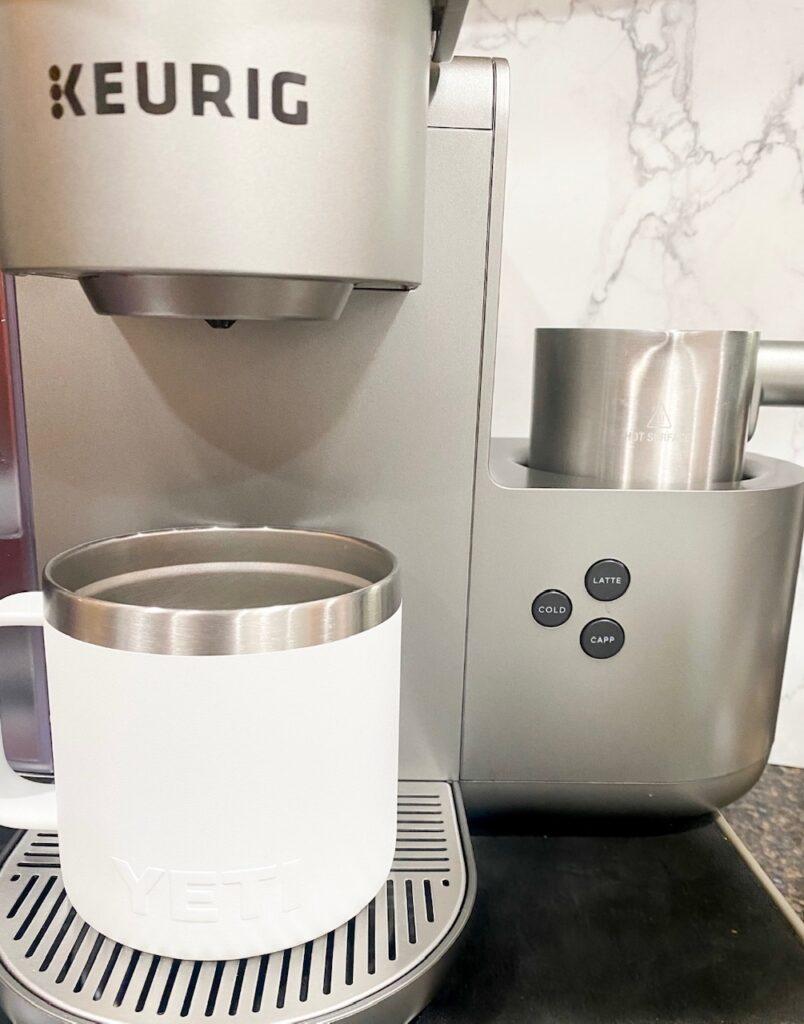 Keurig cafe coffee machine usied to make pumpkin spice drinks.