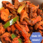 healthy indian lunch spicy chicken tandoori masala and onions and peppers