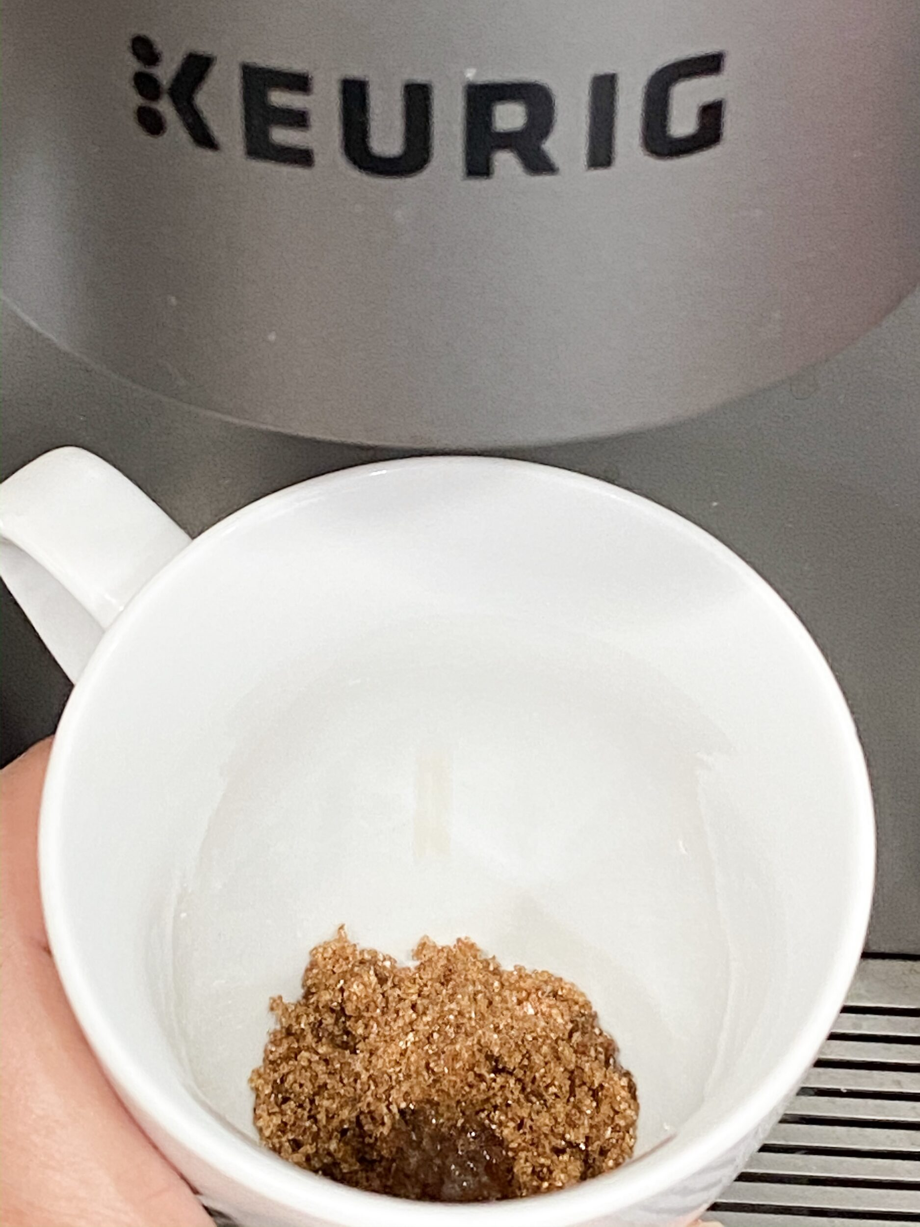brown sugar under a coffee machine ready for espresso to be brewed on top of it