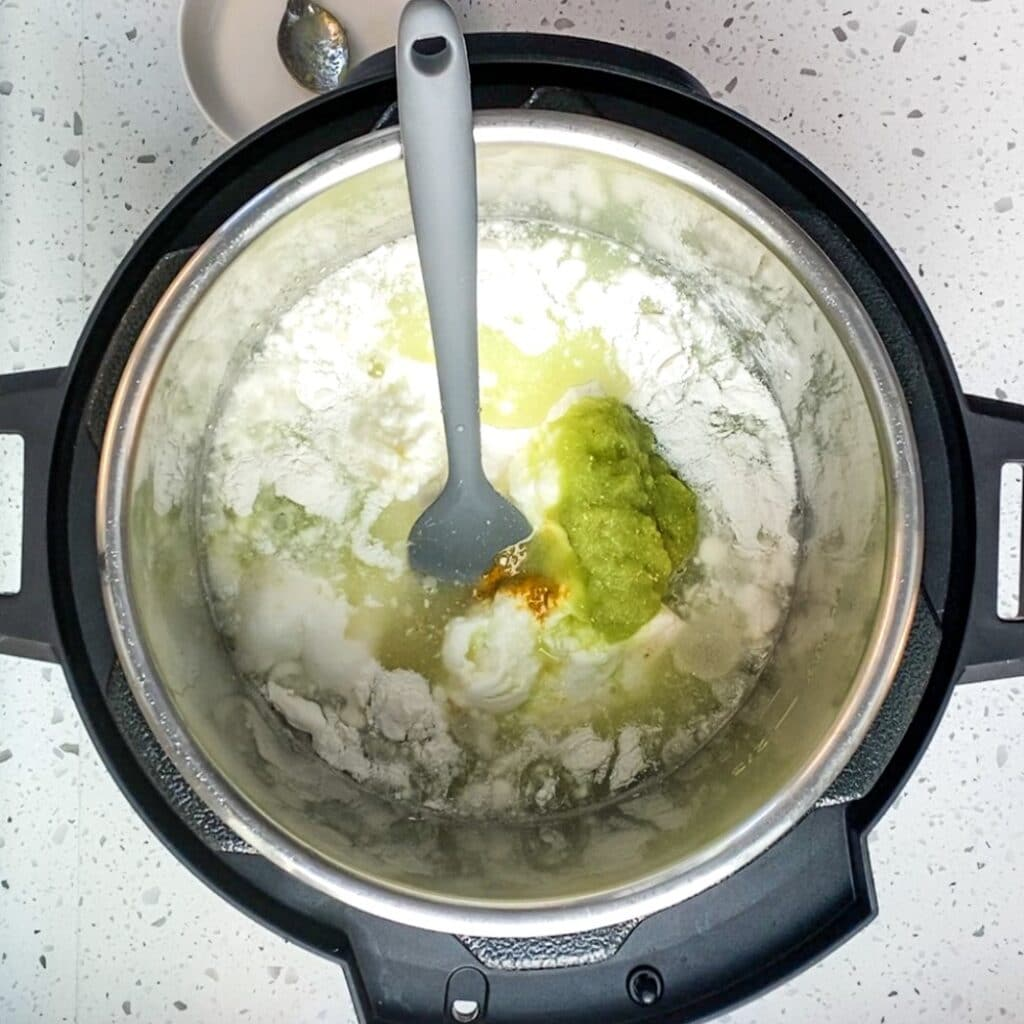 combined khatta poodla ingredients in an instant pot with a spatula