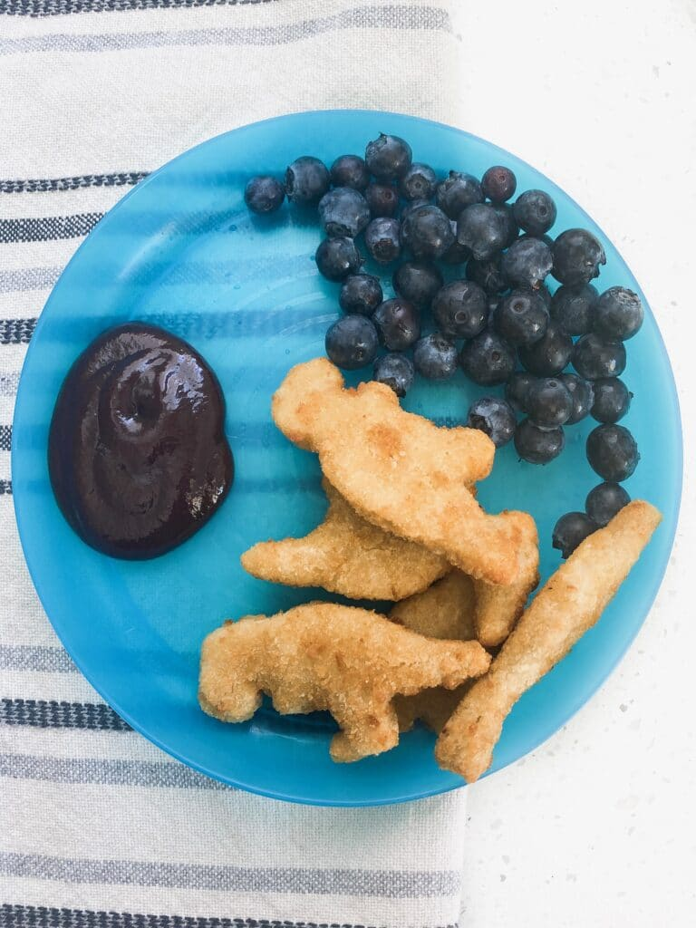 blue plate with blueberries bbq sauce and protein for kids