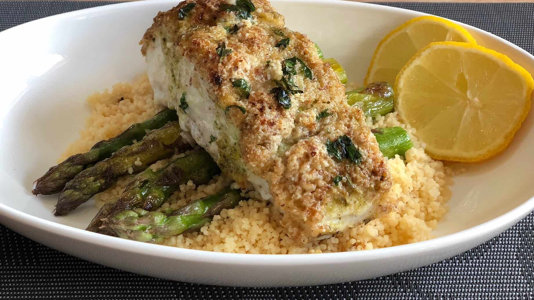 almond crusted halibut on top of asparagus