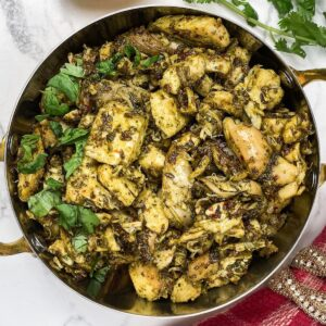 jeera chicken in a copper bowl made with rotisserie chicken