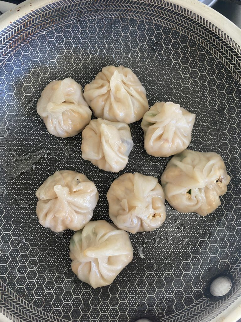 cooked momos in a pan with no more water