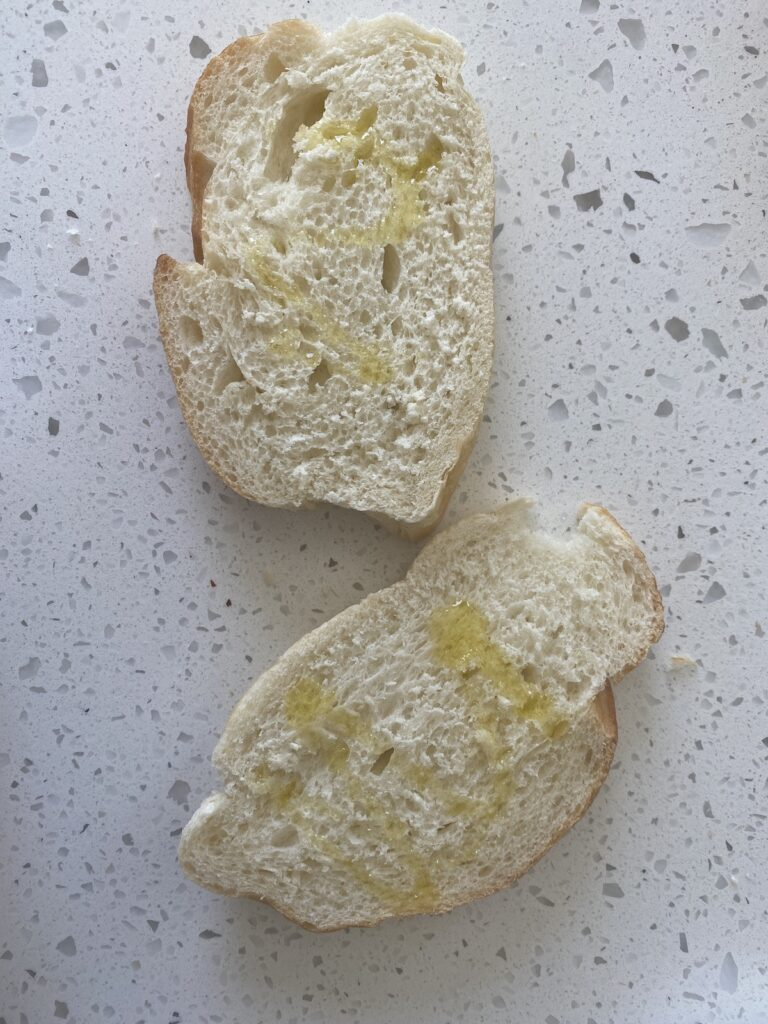 2 slices of french bread with olive oil